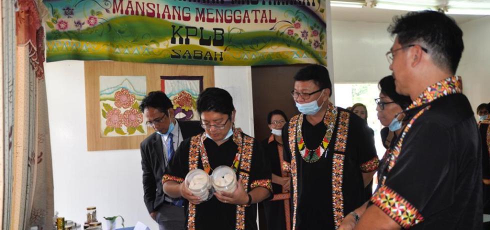 Sabah Minister Datuk Ewon Benedick looking at traditional food.