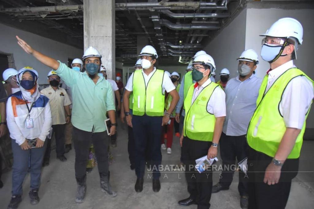 Khairy (centre) inspecting Tawau hospital upgrading project